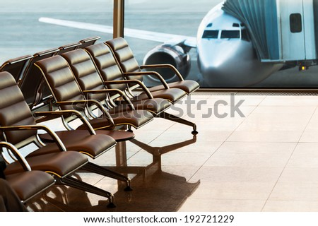 Seats, view from airport hall. Boarding. - stock photo