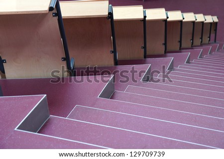 seats with stairs in university hall - stock photo