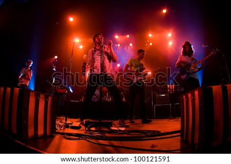 SEATTLE - April 7:  Sameer Gadhia of alternative Indie rock band Young the Giant performs with the group in front of a sold out audience at the Moore Theater in Seattle, Washington on April 7, 2012. - stock photo