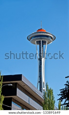 SEATTLE - APRIL 21:  The Spaceneedle, an icon of Seattle celebrates its golden 50th year anniversary with a new Galaxy Gold top.  Events held on April 21, 2010 in Seattle  WA. - stock photo