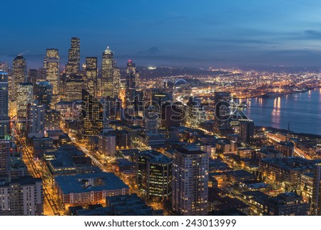 Seattle at Dusk. Seattle,  WA USA - January, 8 2014. Beautiful panorama of Seattle opens from Space Needle observation deck. - stock photo