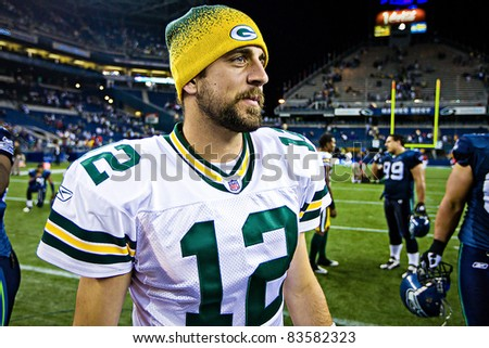 SEATTLE - AUGUST 21:  Superbowl Champion Green Bay Packers Quarterback Aaron Rodgers walks on Qwest Field after winning a football game August 21, 2010 in Seattle, Washington. - stock photo