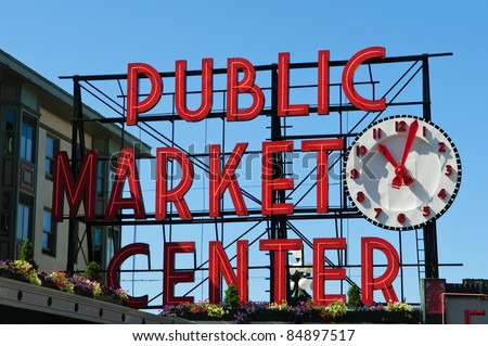 SEATTLE - AUGUST 19: The Pike Place Public Market Historic District on August 19, 2011 in Seattle, USA. Pike Place Market is a famous market's in the United States serving 10 million people annually. - stock photo