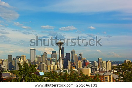 Seattle city skyline with Mount Rainier on background in summer. Seattle city panorama and Mount Rainier with a snow top. - stock photo
