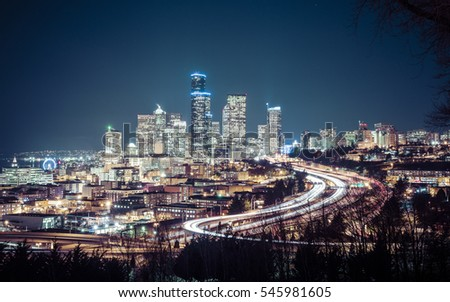 Seattle cityscape at night with traffic light on freeway,Washington,usa.