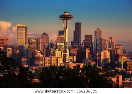 Seattle cityscape in the early sunset with orange glow lights - stock photo