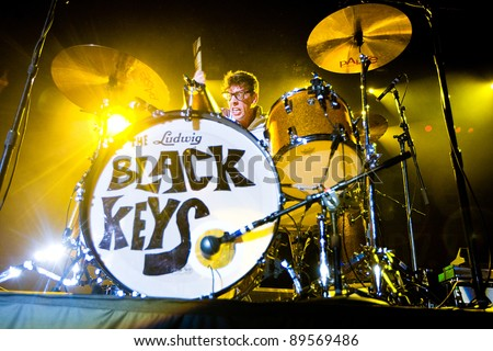 SEATTLE - DECEMBER 8: Drummer Patrick Carney of Indie Rock Band the Black Keys playing the drums live in concert during the Deck the Hall Ball in Seattle, WA on December 8, 2010. - stock photo