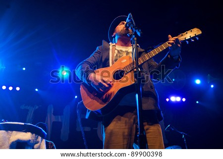 SEATTLE - DECEMBER 8, 2011:  John McCrea of alternative rock band Cake performs on stage during the Deck the Hall Ball in Seattle on December 8, 2011. - stock photo