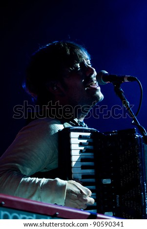 SEATTLE, DECEMBER 7, 2011:  Singer Marcus Mumford of rock band Mumford and Sons performs on stage at Key Arena in Seattle during the Deck the Hall Ball on December 7, 2011.