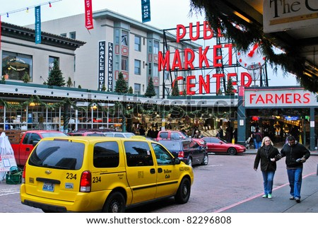 SEATTLE - DECEMBER 05: The Pike Place Public Market Historic District on December 05, 2010 in Seattle, USA. Pike Place Market  is one of the oldest farmers' markets in the United States. - stock photo