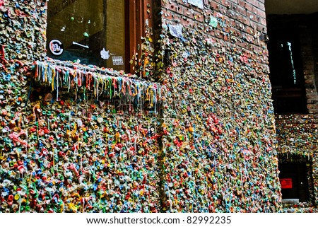 SEATTLE - DECEMBER 05: The The Market Theater Gum Wall Seattle Post Alley on December 05, 2010 in Seattle, USA. Gum Wall was named one of the top 5 germiest tourist attractions in 2009. - stock photo