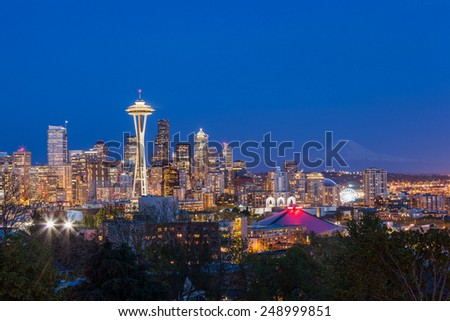 Seattle downtown skyline and Mt. Rainier at night, Washington. - stock photo