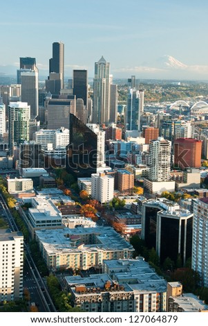 Seattle downtown skyline with view of Mt.Rainier in distance - stock photo