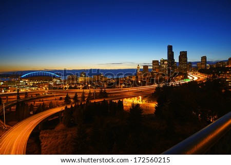 seattle downtown with interstate highway at dusk - stock photo