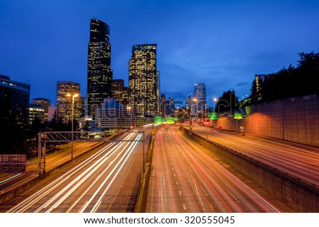 Seattle Freeway Traffic. Commuter travel on Interstate 5 during rush hour during a beautiful Pacific Northwest sunset. - stock photo