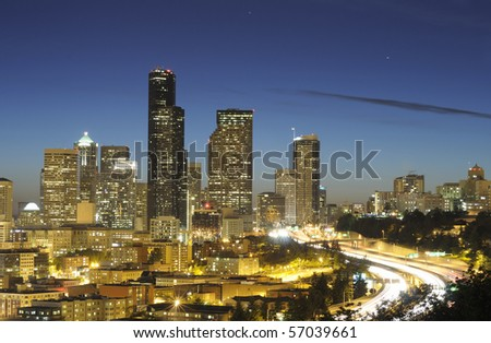 Seattle highrise and highway at night