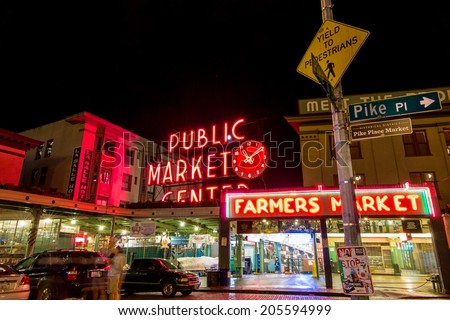 SEATTLE - JULY 5: The Public Market Center also known worldwide as Pike Place Market at night in Seattle, Washington on July 5, 2014.