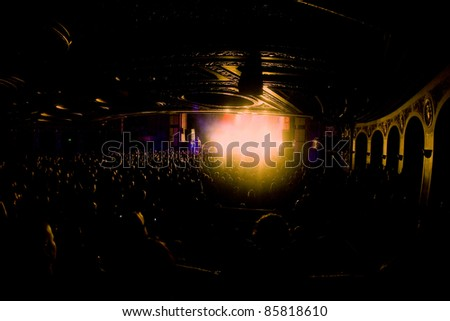 SEATTLE - JUNE 27:  A packed house filled with fans of the Dropkick Murphys cheer inside the Paramount Theater in Seattle on June 27, 2011. - stock photo