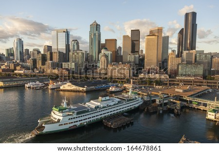 SEATTLE - JUNE 11 2013: Aerial photograph of City Skyline and car ferry , June 11, 2013 in Seattle, Washington, USA.  - stock photo