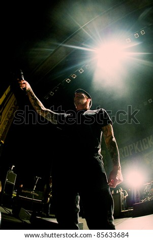 SEATTLE - JUNE 27:  Al Barr of the American Punk Rock Band the Dropkick Murphys performs on stage at the Paramount Theater in Seattle, WA on June 27, 2011