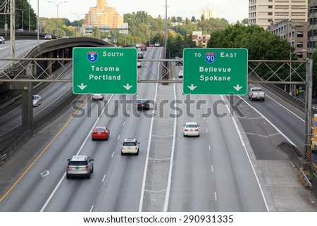 SEATTLE - JUNE 24, 2015 - View of the traffic on Interstate 5 (I5) looking south after rush hour. The directional signs for the cities of Portland, Spokane, Bellevue and Tacoma are displayed. - stock photo