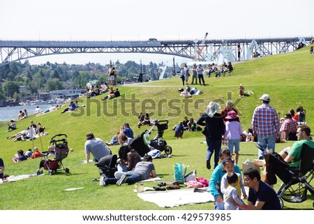 SEATTLE - MAY 30, 2016 - Dozens of people celebrate a relaxing Memorial Day at Gas Works Park - stock photo