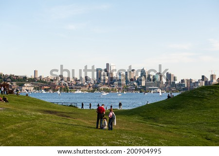 SEATTLE - MAY 11: Families and friends gather at Gas Works Park in Seattle which overlooks Lake Union and the Seattle Skyline on May 11, 2014. - stock photo