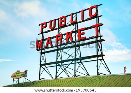 SEATTLE - MAY 9: Famous Pike Place market sign on May 9, 2014 in Seattle, WA. The Market opened in 1907, and is one of the oldest continuously operated public farmers' markets in the US. - stock photo