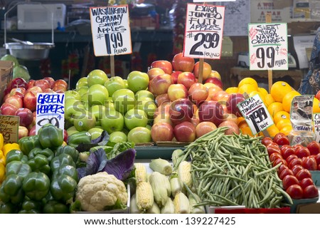SEATTLE MAY 10: One of the vendors shows her food produce for sale at the Pike Place Public Market in Seattle near the Puget Sound on May 10, 2013. - stock photo