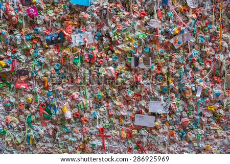 SEATTLE May 15th 2015: A Gum Wall background in downtown Seattle. It is a local landmark in Post Alley under Pike Place Market, Seattle Washington - stock photo