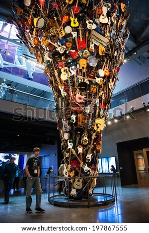 SEATTLE - MAY 8: The Roots and Branches Sculpture at the EMP Museum on May 8, 2014 in Seattle. The Roots and Branches Sculpture is composed of nearly 700 instruments. - stock photo
