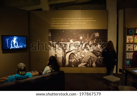 "SEATTLE - MAY 8: Visitors of the EMP Museum experience the exhibit ""Nirvana: Taking Punk to the Masses"" on May 8, 2014 in Seattle. - stock photo"