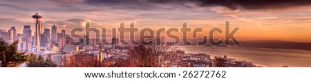 Seattle & Mount Rainier with triple lenticular clouds at Sunset - stock photo