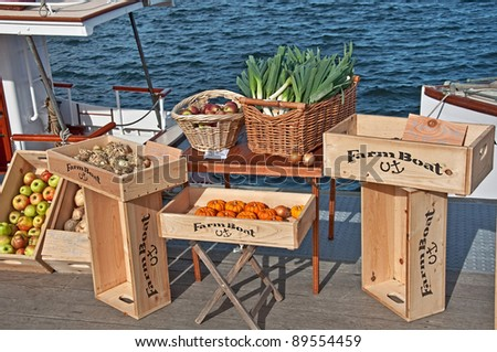 SEATTLE - NOV 9:  Fresh produce is sold at Lake Union's Floating Farmers Market aboard historic Virginia V ship built to transport farm products in 1922.  Held on November 9, 2010 in Seattle, WA. - stock photo