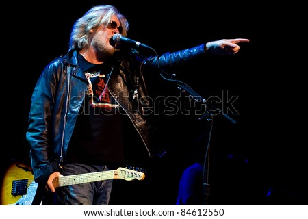 SEATTLE - SEPT. 5: World famous singer and guitarist Daryl Hall of American Rock Band Hall and Oates performs on stage during the Bumbershoot Music Festival in Seattle on September 5, 2011. - stock photo