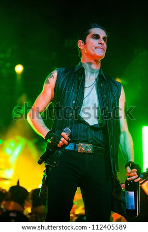 SEATTLE - SEPTEMBER 1, 2012:  Lead singer Perry Farrell of rock band Jane's Addiction performs on the main stage at Key Arena during the Bumbershoot music festival in Seattle, WA on September 1, 2012 - stock photo