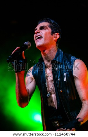 SEATTLE - SEPTEMBER 1, 2012:  Lead singer Perry Farrell of rock band Jane's Addiction performs on stage at Key Arena in Seattle during the music festival Bumbershoot on September 1, 2012.