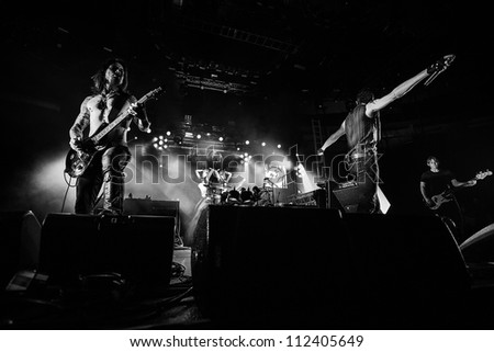 SEATTLE - SEPTEMBER 1, 2012:  Rock band Jane's Addiction performs on the main stage at Key Arena during the Bumbershoot music festival in Seattle, WA on September 1, 2012 - stock photo