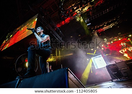 SEATTLE - SEPTEMBER 1, 2012:  Singer Perry Ferrell of rock band Jane's Addiction performs on the main stage at Key Arena during the Bumbershoot music festival in Seattle, WA on September 1, 2012 - stock photo