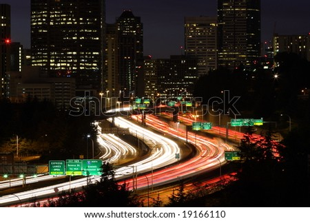 Seattle skyline and highway traffic at dusk - stock photo