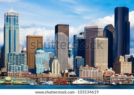Seattle skyline and waterfront view.  Bright light on a sunny day with clouds. - stock photo
