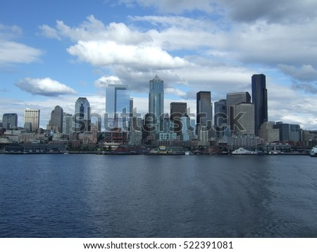 Seattle Skyline as seen from a Washington State ferry as it approaches the iconic and justly named Emerald City.