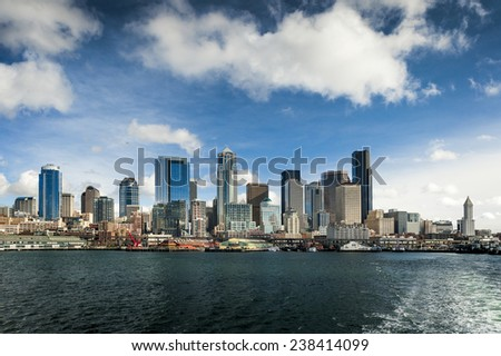 Seattle Skyline from a Ferryboat. Seattle Skyline after leaving the Coleman Ferry dock during a lovely sunny day in the Pacific Northwest. - stock photo