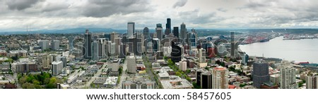 Seattle Skyline including high rise towers and surrounding harbor and suburbs. - stock photo