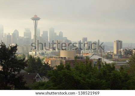 Seattle Skyline, Morning Mist. Fog lingers around downtown Seattle at sunrise. Washington State, USA.  - stock photo
