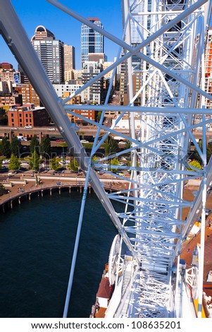 Seattle skyline viewed from waterfront ferris wheel.  Sunny day with a bright blue sky. - stock photo