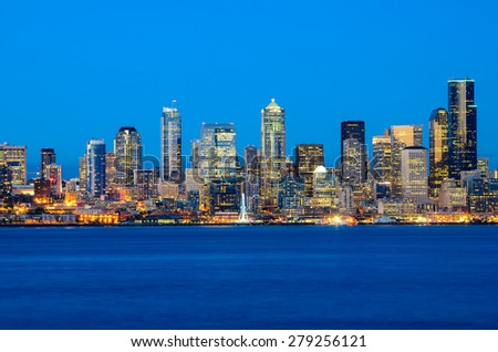 Seattle skylines in blue hour from Alki Beach, West Seattle, Washington, USA. - stock photo