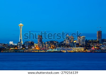 Seattle skylines in blue hour from Alki Beach, West Seattle, Washington, USA.