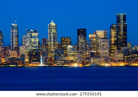 Seattle skylines in blue hour from Alki Beach, West Seattle, Washington, USA. - stock photo