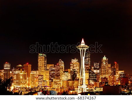 Seattle Space Needle in Golden Glow at Night - stock photo